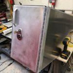 lock on raw metal door